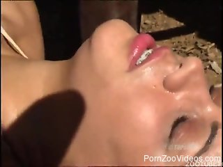Curly-haired babe is blowing a stallion dick
